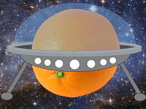 {An orange flying through space looking like a UFO}